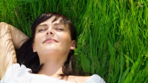 happy woman in grass istock